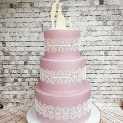 Pink and lace wedding cake