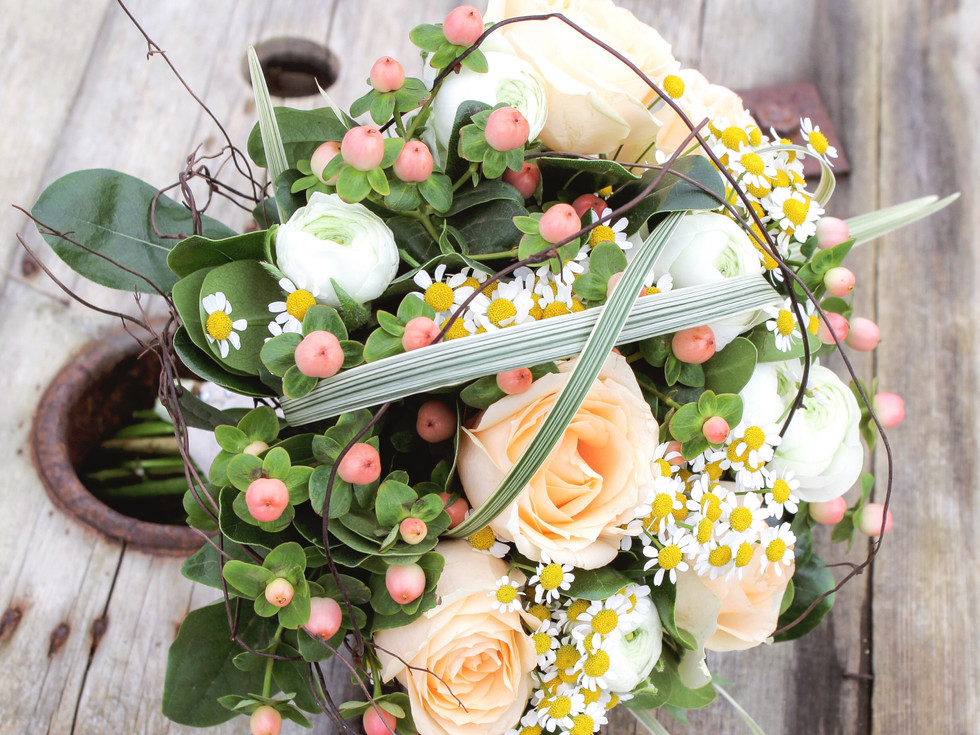 apricot and white bridal bouquet by buds to bouquets