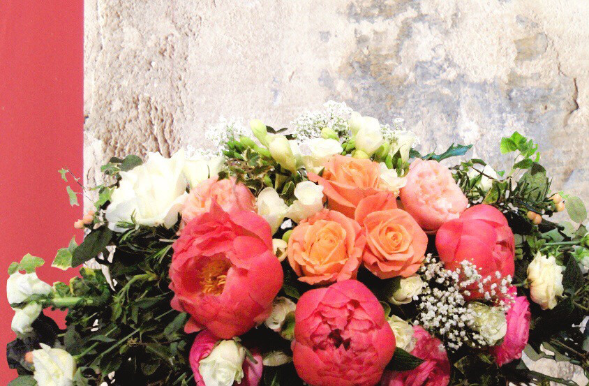flower display by buds to bouquets bright peonies and white roses