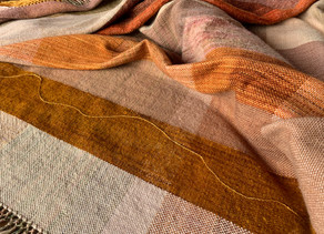 Wrapped in the Sahara Desert blanket handwoven by Skeinydipping