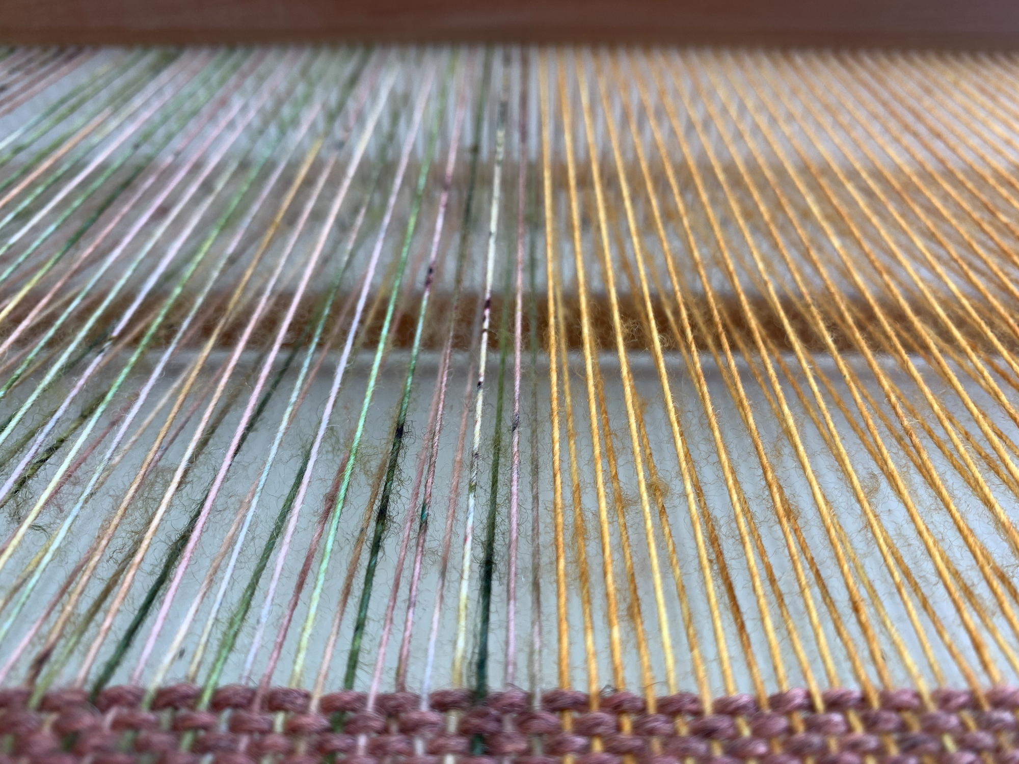Warp threads using indie-dyed merino yarn