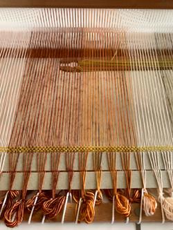 Simple shuttle weaving.