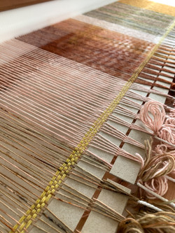 Placement strips and header on loom.