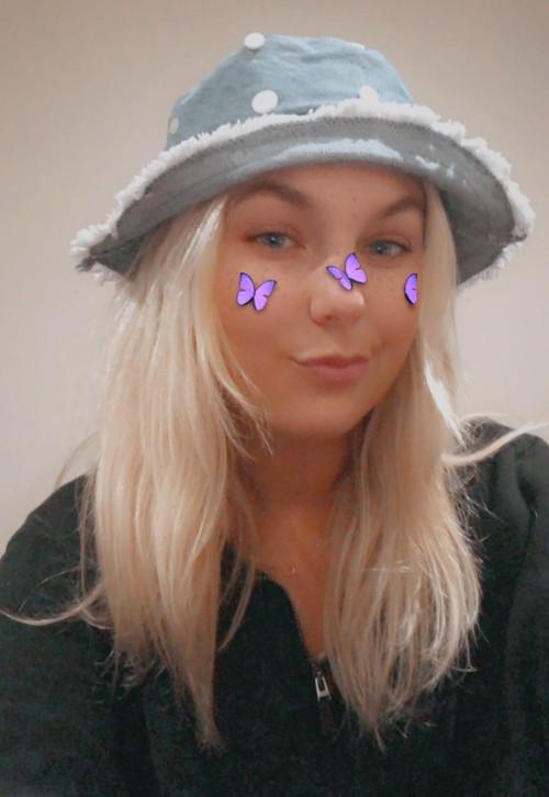 Caroline in our Button Denim Bucket Hat
