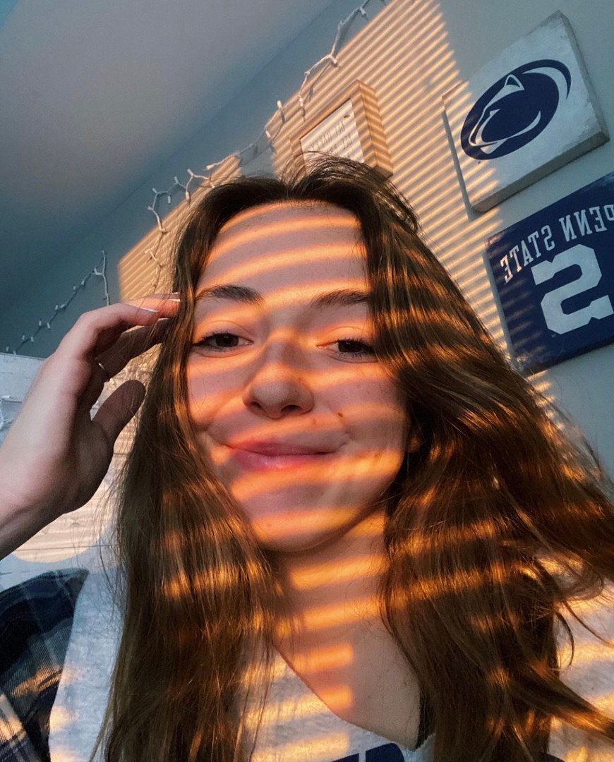 Mary in our Flannel Sleeve PSU Sweatshirt