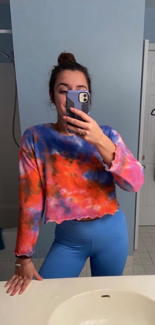 Liv in our Tie Dye Lettuce Hem Sweatshirt
