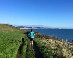 Dog walker Exmouth. Dog walker East Devon. Dog walker Otterton. Dog walker Budleigh Salterton. Dog walking Exmouth, dog walking Budleigh Salterton, dog walking East Devon, pet sitting East Devon, pet sitting Exmouth, pet sitting Budleigh Salterton, Pet sitting Topsham, dog running, dog exercise Exmouth, sandy paws and waggy tails Exmouth, South West coast path, Devon, pet services East Devon, emergency service police fire NHS RNLI coastguard discount, trail running