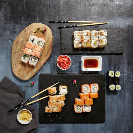 74432574-japanese-sushi-set-of-maki-sushi-roll-soy-sauce-and-ginger-over-stone-background-top-view-j