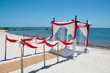 key west beach wedding canopy with red and white decorstions