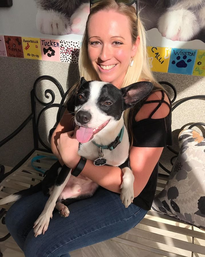 Woman adopting a dog at Hope for Life Rescue