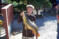 tribesman-kid-fish.jpg