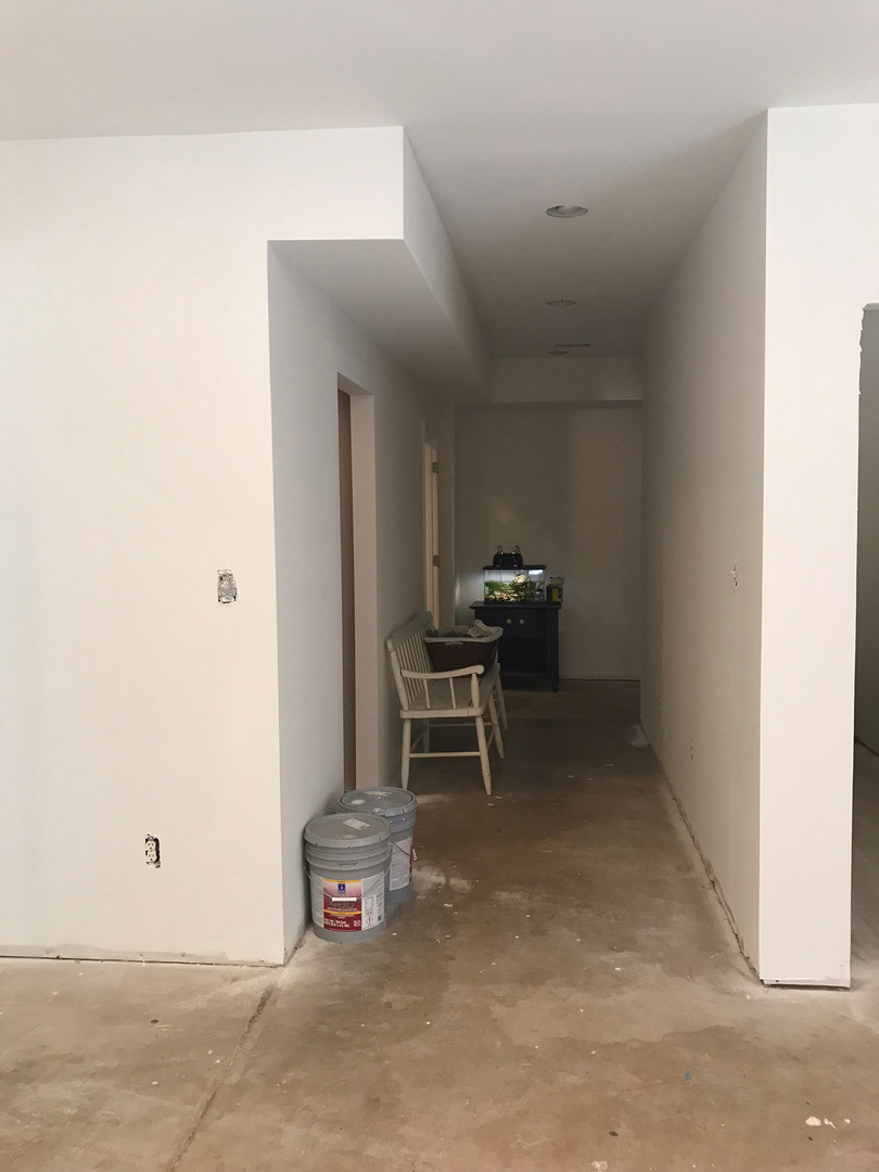 Basement Hallway Before
