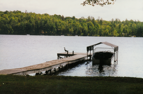 Camp dock & boathouse of yesteryear.