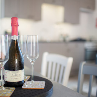 Prosecco and Glasses on Serving Tray in Casa Nestore Room
