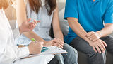 Patient couple consulting with doctor or