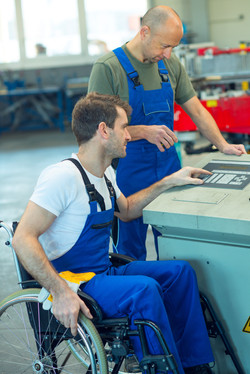disabled worker in wheelchair in factory