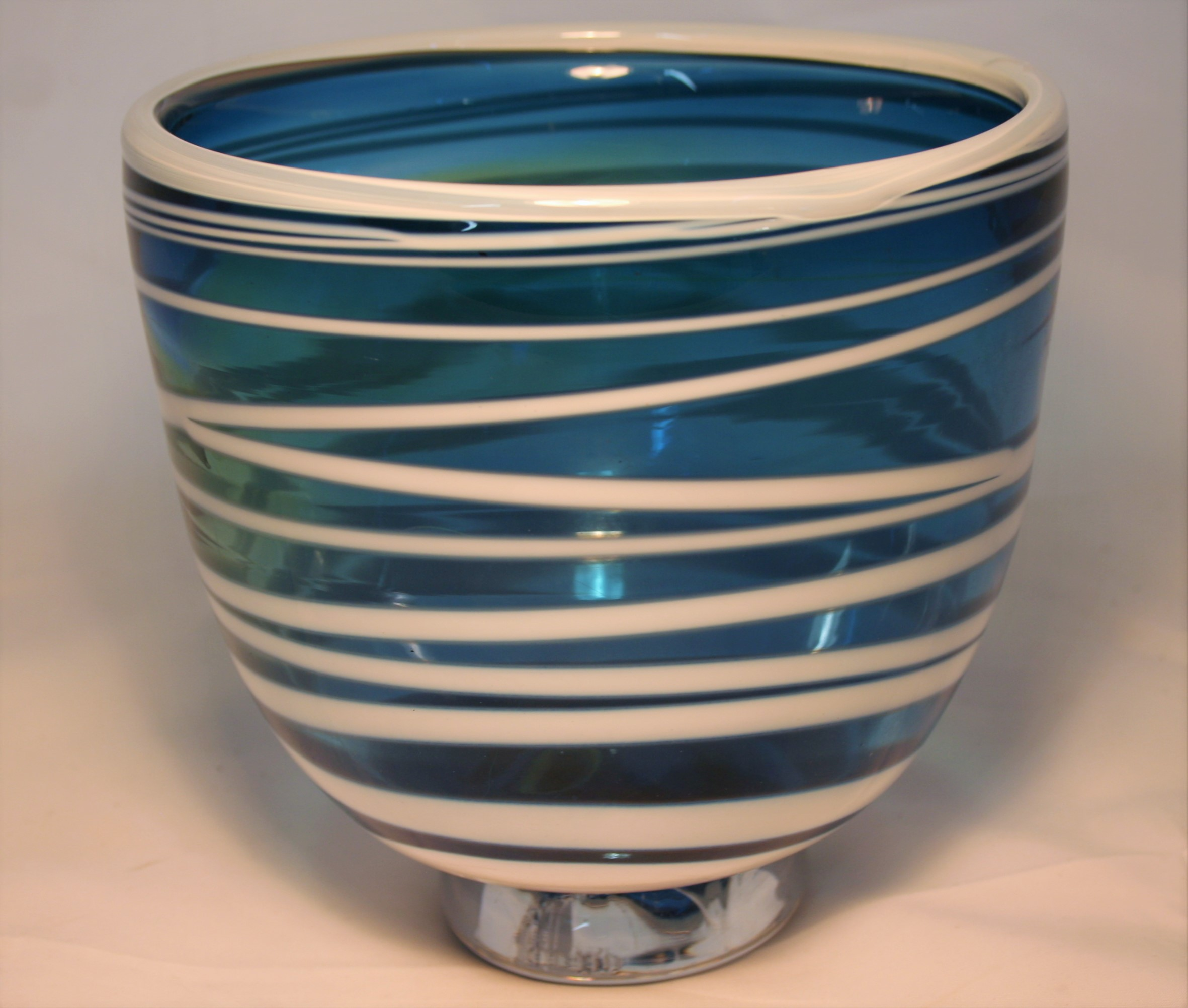 Turquoise with white wrap glass bowl