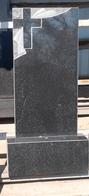 Чёрный гранитный памятник с резьбой по камню