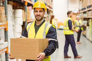 warehouse-worker-smiling-at-camera-carry