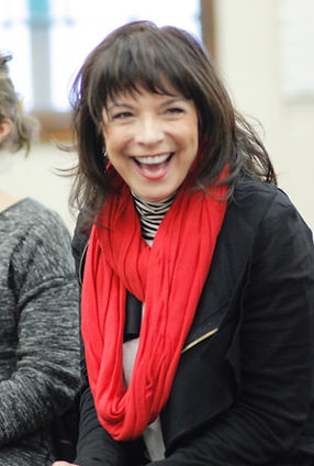 Vicki Shaghoian, oneof NYC's Best Voice Teachers, laughing with her students.