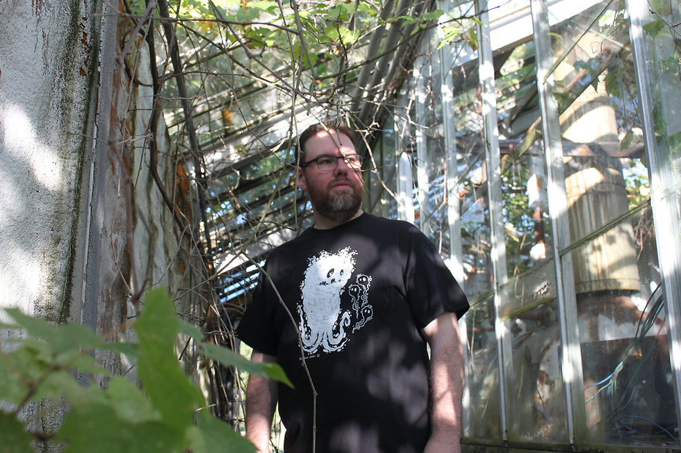 Mark S Gagne in an abandoned greenhouse