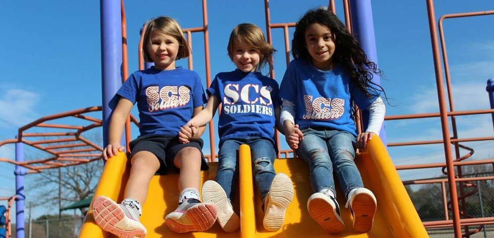 Scofield girls on slides.jpg