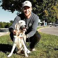 Christian Dickson is a dog trainer at Cosmic Canine near Dallas, Texas