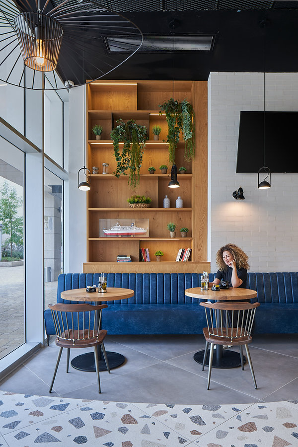 Gila Winter - Arto Cafe and glass corrid