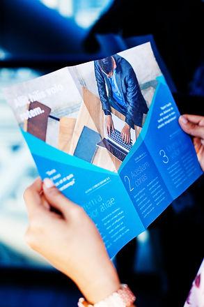 Hands holding a business brochure.jpg