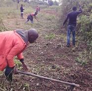 Matovu, Boy, & some of the kids clearing