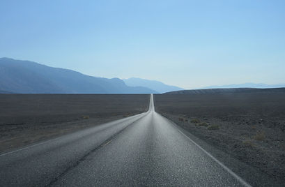 Road through desert with mountains
