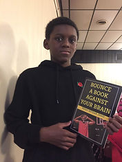 WIX AUTHOR PAGE BOY HOLDING BOOK.jpg