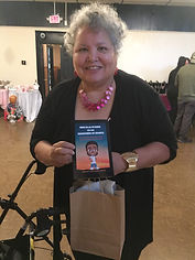 WIX AUTHOR PAGE WOMAN HOLDING BOOK 1.jpg