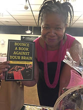 WIX AUTHOR PAGE WOMAN HOLDING BOOK 2.jpg