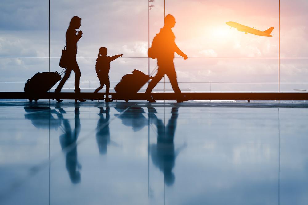 A family walking through an airport