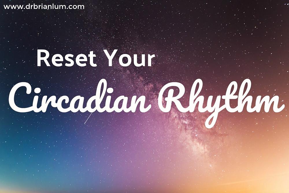 the night sky. text overlay says reset your circadian rhythm