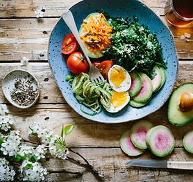 A Healthy Meal of Egg, Tomato, Kale, Zucchini and Avocado.