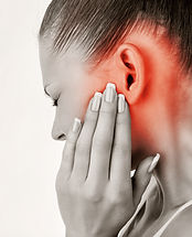 woman with unexplained head pain denoted by a red color