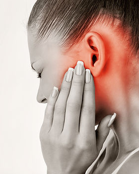 Young woman with ear pain, holding head