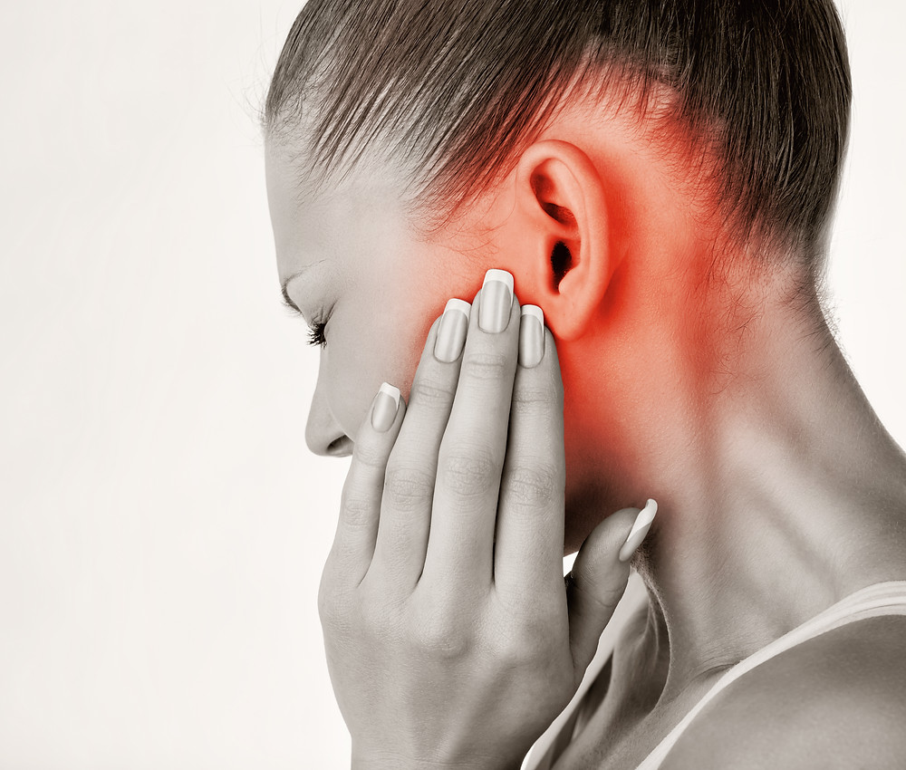 woman with ear pain.