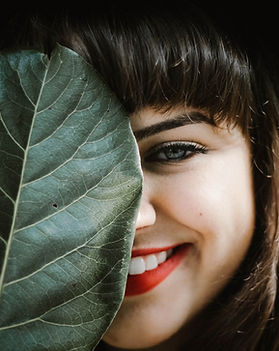 Girl Smiling with Leaf