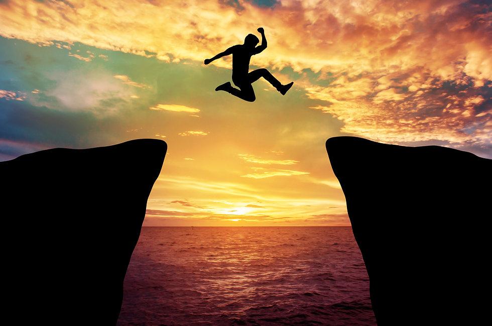 Man jump through the gap between hill..j