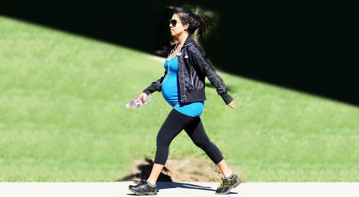 Mysouls pregnant lady walking in the park to keep healthy