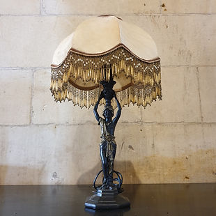 black lady table lamp with beaded shade