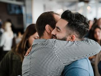 Childhood friend- Alex- hugging at book