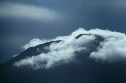 MOUNTAIN RANGE IN CLOUDS