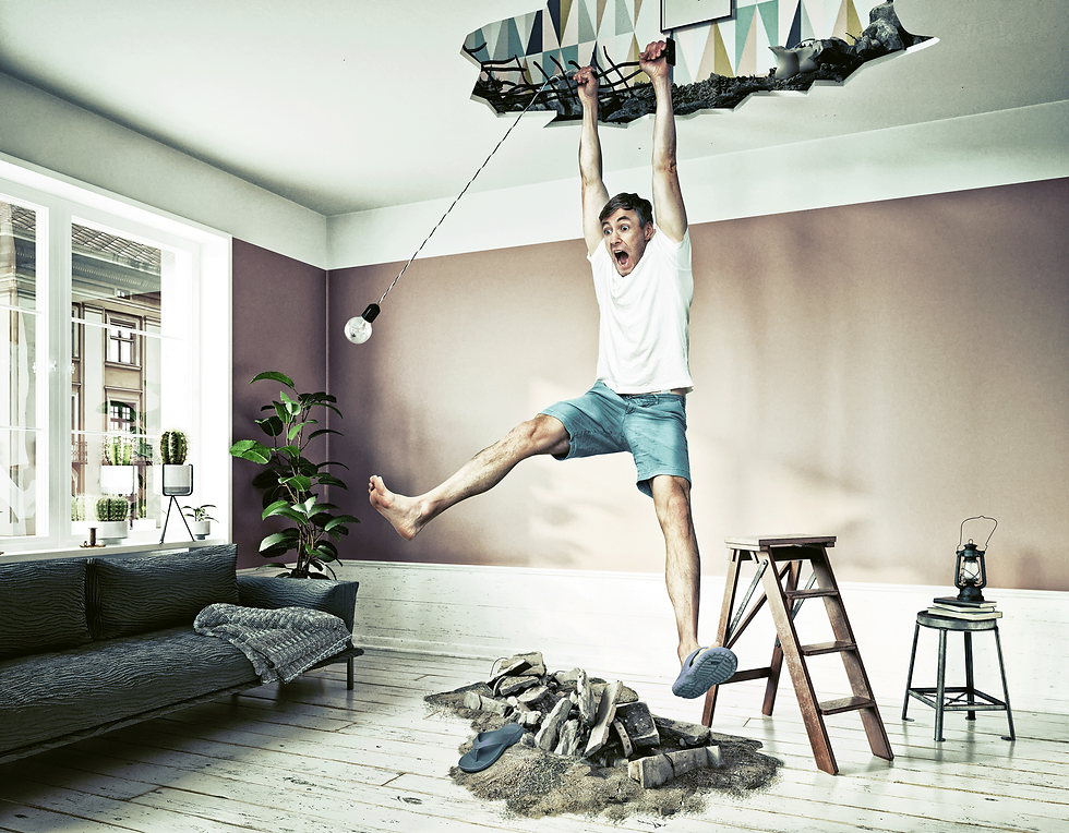 AdobeStock_278174015-man-hanging-from-ce