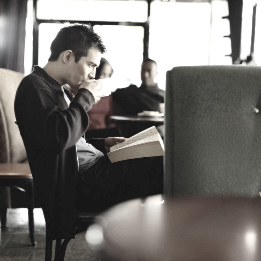 Man Reading to Educate Himself