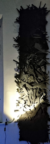 Pillar - Relief piece featuring over 400 silhouettes of high heels