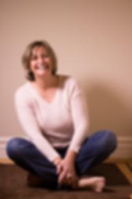 Eva Farkas Sitting on a Rug, Laughing, Having Fun During a Photo Shoot